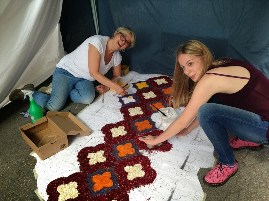 Mother and daughter join hands on a floral creation